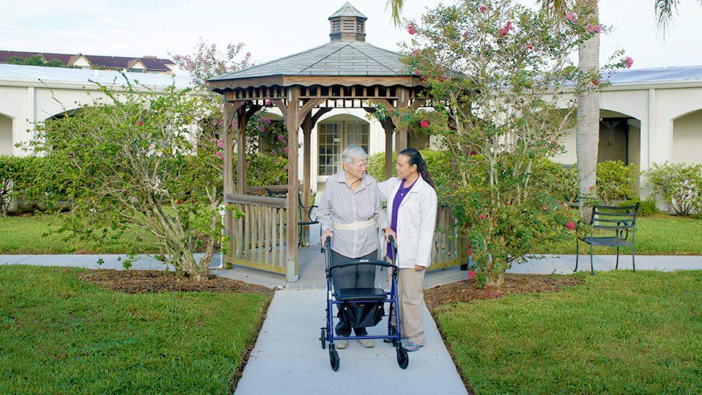 Patient with Therapist in Garden 2