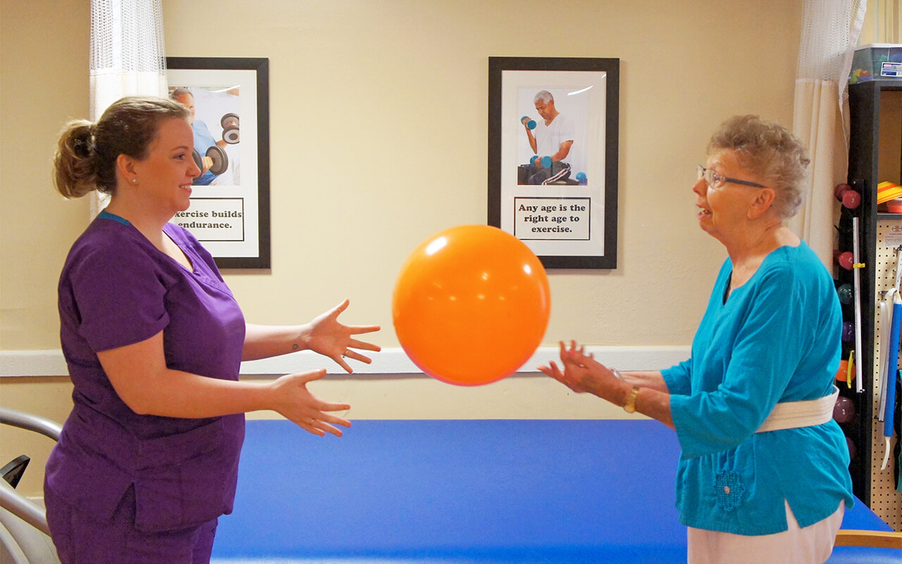 Therapist with Patient Ball throw